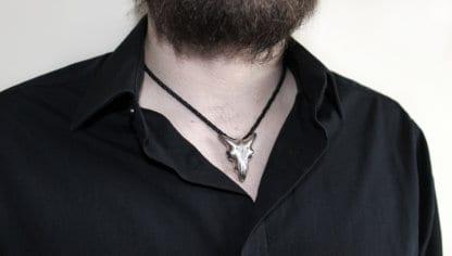 bearded man wearing Hjälte Jewellerys goat skull pendant on a leather string